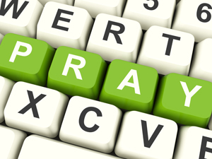 computer keyboard keys with word 'pray'